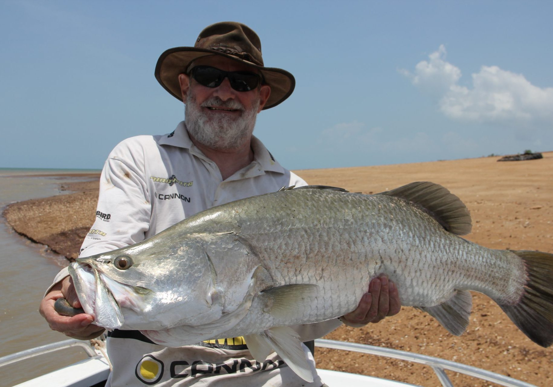 Tony Errity with a magnificent barra just one cm short of the magic metre mark!